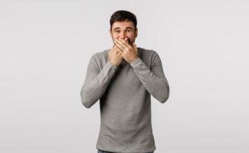 man hiding smile
